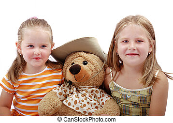 Childre with teddy bear - Studio portrait of two sister with...