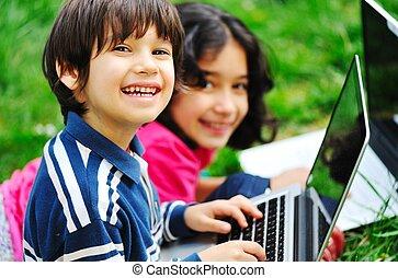 Children activity with laptop in nature