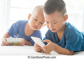 Children addicted to smart phone.