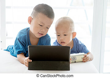 Children addicted to tablet.