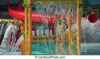 children amusement water park. Streams of water flowing from...