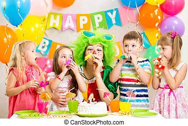children and clown at birthday party - children and clown at...