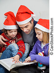 Children And Father Reading Book