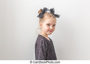 Children and festive concept - happy little girl a on white background