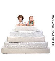 Children and many mattresses