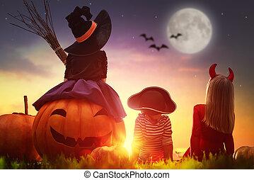 children and pumpkins on Halloween