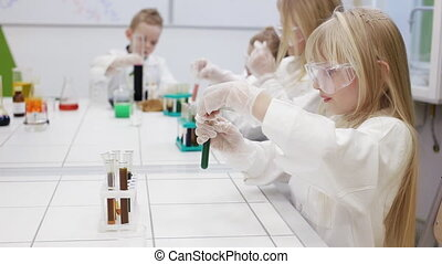 Children are experimenting in a chemistry lesson