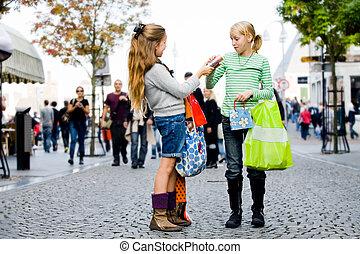 Children are shopping - Two yuong children hanging around...