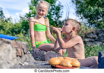 Children at a barbecue in a sunny day of summer