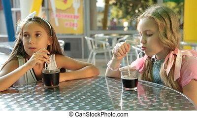 Children at a fast food restaurant - Two ten-year girls...