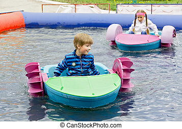 Children at play on a boat attraction