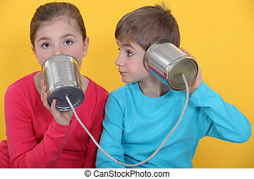 children at play with cans