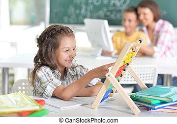 children at school in the classroom