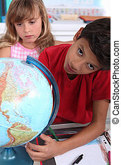 Children at school with a globe