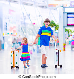 Children at the airport - Two children traveling by airplane...