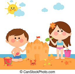 Children at the beach building a sandcastle