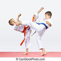 Children athletes are training kicks legs