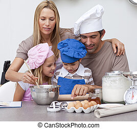 Children baking cookies with their parents