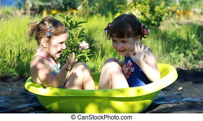 Children bathe in the water, play, laugh and have fun. Happy...