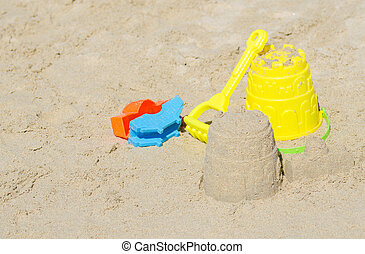 Children beach toys on the sand.