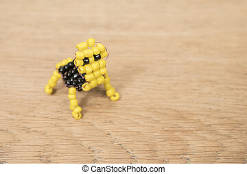 children beadwork on the table - yellow and black baby ...