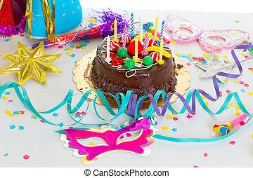 Children birthday party with chocolate cake confetti garland...