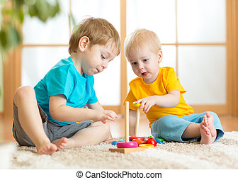 children boys with toys in playroom - children boys with ...