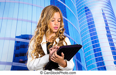 Children business student girl with tablet pc on urban blue buildings background