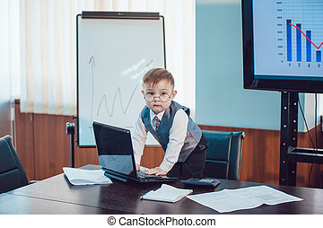 Children businessmen are meeting in the office