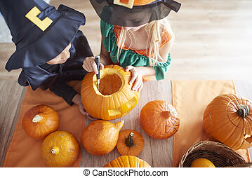 Children carving from the pumpkin