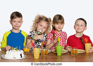 Children celebrate a birthday at the table