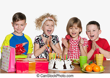 Children celebrate birthday at the table