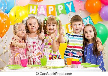 children celebrating birthday party