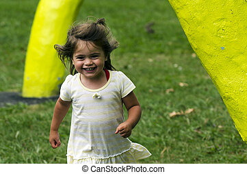 Children - Childhood - Little girl play in a playground.