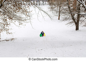 children climb the mountain in winter time