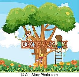 Children climbing up the tree in the garden