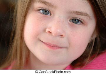 Close up head shot of an adorable girl