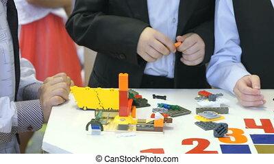 Children collecting intellectual designer.Close-up -...