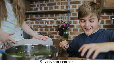 Children Cooking Food Together In Kitchen With Parents Embracing Drinking Wine, Happy Family Preparing Meal At Home