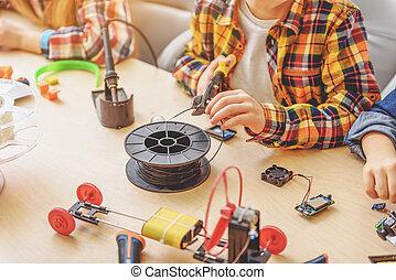 Children creating new interesting toy