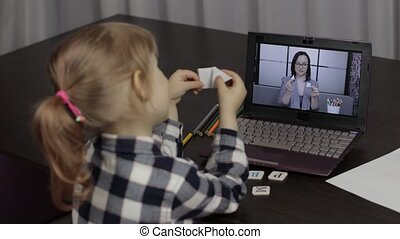 Children distance education on laptop. Online lesson at home with woman teacher