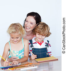 Children doing homework with their mother