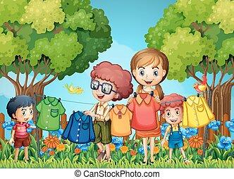 Children doing laundry in the garden