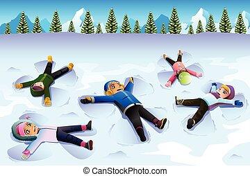 Snow angel boy. Happy little boy lying down on the ground ...