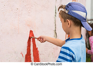 children draw a picture on the wall