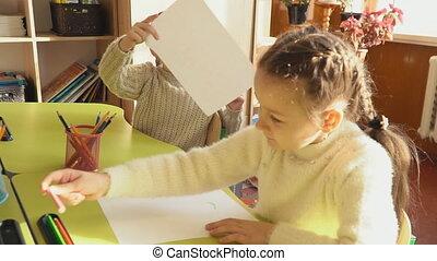 children draw at school