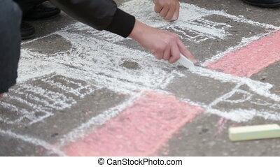 Children draw on the asphalt