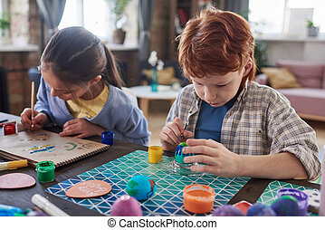 Children drawing at the table