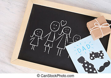 Children drawing on a blackboard. Father's day concept