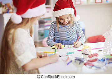 Children drawing some christmas paintings